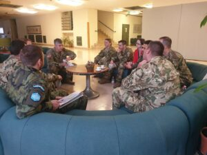 Figure 2. NATO training in negotiations. Two teams discuss possible agreement leading to deescalation and successfully managed incident.